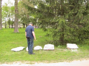 Looking at the five remaining gravestones of the Old Jewish Cemetary/Park Slavy Komsomola, Nyesviz, Belarus